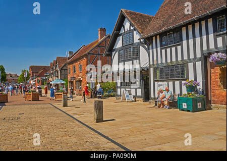 Stratford upon Avon and half timbered medieval buildings and brick buildings in Henley Street. - Stock Image