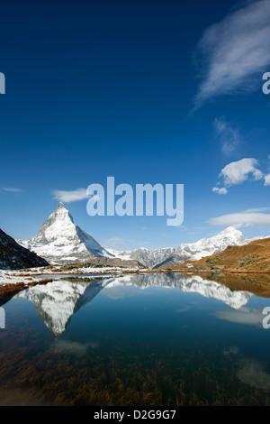 Riffelsee with Matterhorn, Dent Blanche and Obergabelhorn mountain peaks, Zermatt, Switzerland - Stock Image