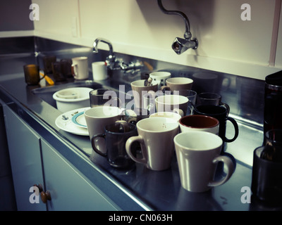 Coffee break washing up - Stock Image