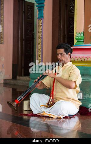 Musician Playing a Nadaswaram, an Indian Wind Instrument, Sri Mahamariamman Hindu Temple, Kuala Lumpur, Malaysia. - Stock Image