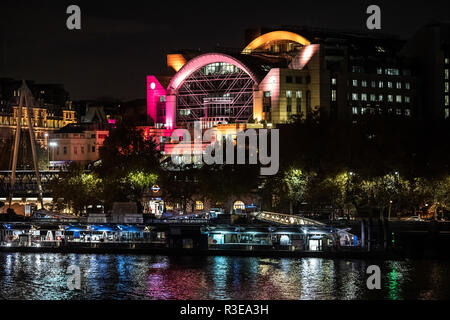 LONDON - NOVEMBER 15 : Charing Cross railway station and the river Thames in London England at night  on 15 November 2018 in London, UK - Stock Image