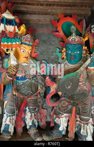 Two of the Four Protectors inside the Kumbum at Pelkhor Chode Monastery, Gyantse, Tibet, China - Stock Image