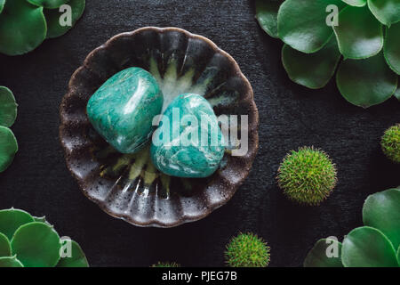 Chrysoprase with Succulents and Spiky Balls on Black Table - Stock Image