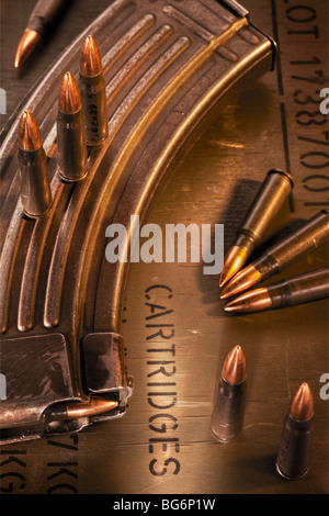 AK-47 clip, ammunition crate and assault rifle cartridges - Stock Image