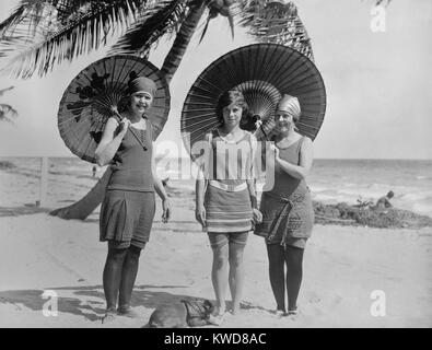 Women pose in bathing suits at an American east coast beach between 1910-1920. The younger woman in the center has - Stock Image