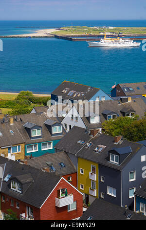 Helgoland Germany colorful houses in town seen from the plateau of the main island toward the island Düne / - Stock Image