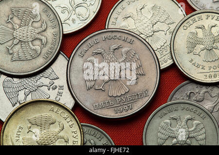Coins of Russia. Russian double-headed eagle depicted in the Russian ruble coins. - Stock Image