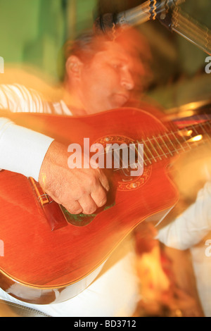 Cuba, Holguin. Musician plays classical guitar at Casa de la Trova. Photo CUBA1256 Copyright Christopher P. Baker - Stock Image