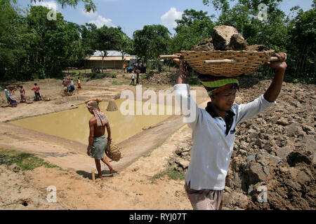 BANGLADESH Farmers digging a fish pond, Garo tribal minority, Haluaghat, Mymensingh region photo by Sean Sprague - Stock Image