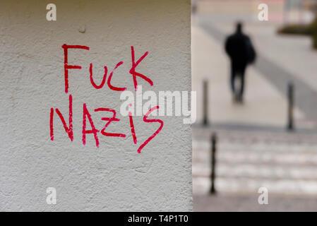 'Fuck Nazis' graffitti written on a wall, Wrocław, Wroclaw, Wroklaw, Poland - Stock Image