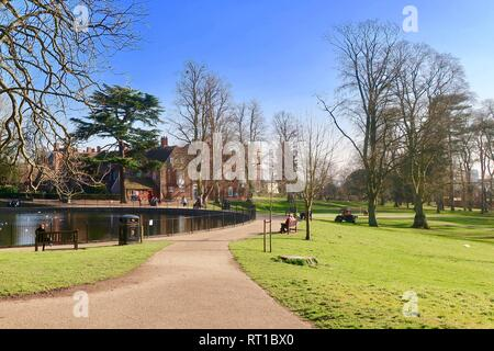 UK Weather: A very warm sunny February afternoon in Christchurch Park, Ipswich, Suffolk. - Stock Image