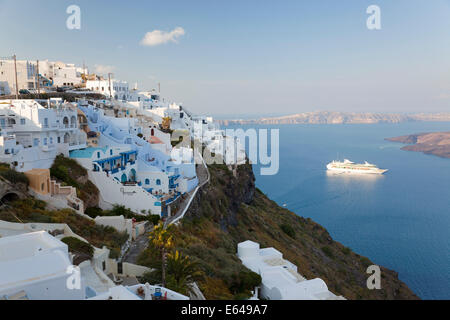 Fira and cruise ship, Fira, Santorini (Thira), Cyclades, Greece - Stock Image