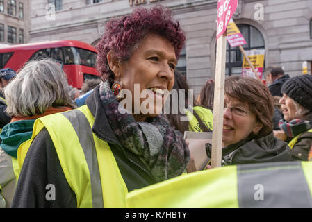 London, UK. 9th Dec, 2018. Protesters line up close to the BBC for the united counter demonstration by anti-fascists marches in opposition to Tommy Robinson's fascist pro-Brexit march. Moyra Samuels of Justice4Grenfell. The march which included both remain and leave supporting anti-fascists gathered at the BBC to to to a rally at Downing St. Police had issued conditions on both events designed to keep the two groups well apart. Credit: Peter Marshall/Alamy Live News - Stock Image