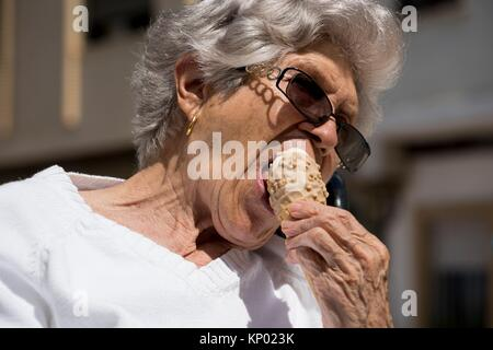 Grandmother eating ice cream, Valencia - Stock Image
