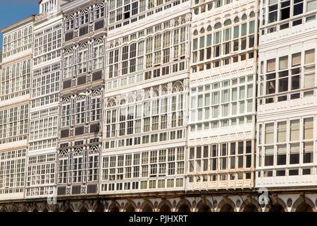 Spain, Galicia, A Coruna, Avenida Marina, characteristic glazed waterfront buildings - Stock Image