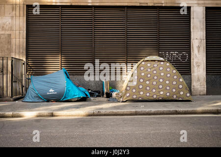 Two homeless tents on Eastcastle Street, just metres from the bustling commercial Oxford Street in London's - Stock Image