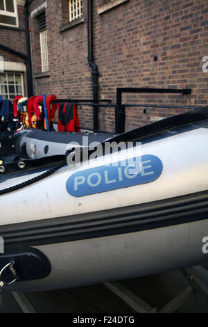 Inflatable boat at Wapping Police station on the bank of the River Thames in London England - Stock Image