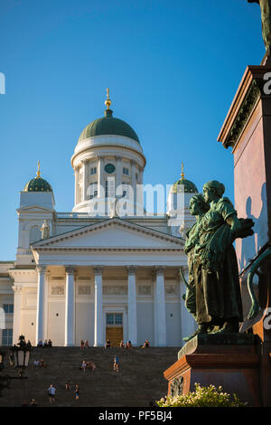 Helsinki Cathedral, view of the Lutheran Cathedral and statues of Nordic women sited on the Alexander ll Monument in Senate Square, Helsinki, Finland. - Stock Image
