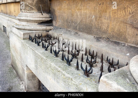 Stone plinth with different shaped iron spikes protruding outside the Mineral water hospital Bath - Stock Image