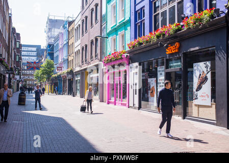 London, England , UK - June 2018: Tourists and people walking and shopping in Carnaby street, London, UK - Stock Image