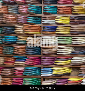 Dyed leather slippers on display for sale near Chouara Tannery, Fes, Morocco - Stock Image