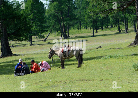 Naadam Festival in Khatgal, Mongolia. Taking a rest - Stock Image
