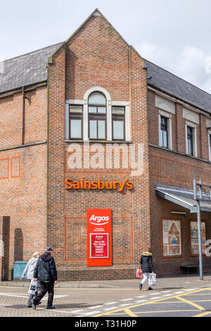Sign for a Sainsbury's supermarket also containing a branch of Argos catalogue shops. - Stock Image
