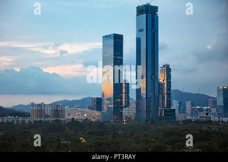 High-rise buildings in Futian District at dusk. Shenzhen, Guangdong Province, China. - Stock Image