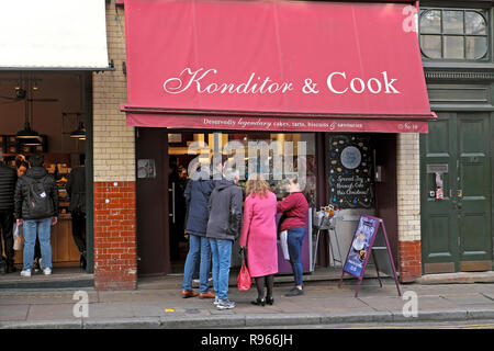 Customers outside Konditor & Cook shop at Christmas time at Borough Market in London England UK  KATHY DEWITT - Stock Image