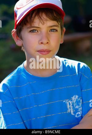 Portrait of boy in cap - Stock Image