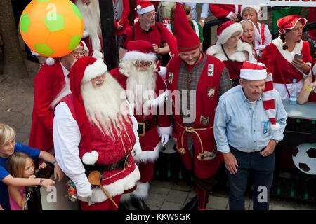Supporters at the football competition between Santas at the Santa Claus World Congress in Denmark at Bakken, the - Stock Image