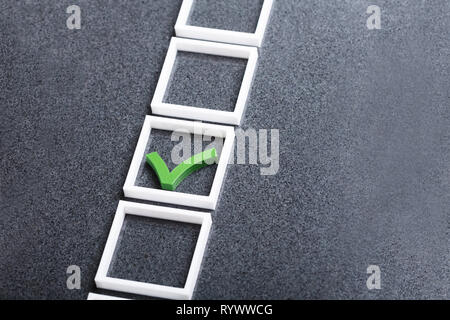 An Elevated View Of Green Check Mark In Checkbox On Gray Background - Stock Image