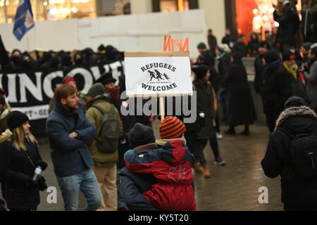 Vienna, Austria. 13th Jan, 2018. protester carrying a child during an anti-government demonstration. the sign reads - Stock Image
