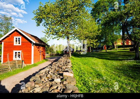 old rural farm houses in a beautiful scenery in Sweden - Stock Image