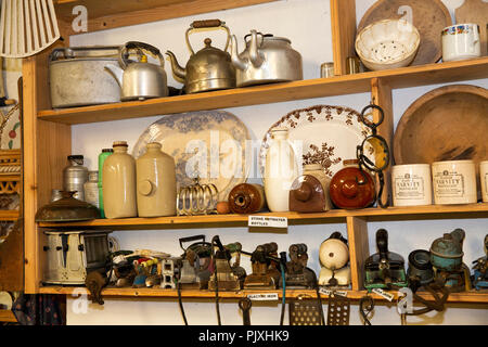 Ireland, Co Leitrim, Ballinamore, Aghoo, Glenview Folk Museum, display of household domestic items with double spout teapot - Stock Image