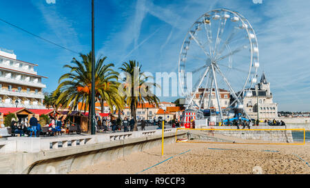 Cascais beach, Lisbon, Portugal - Dec 22, 2018: A giant ferris wheel has been setup at Cascais Beach ahead of the xmas season - Stock Image