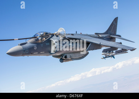 Maj. John Grunke, an AV-8B Harrier pilot with Marine Aviation Weapons and Tactics Squadron 1, trains in his aircraft - Stock Image
