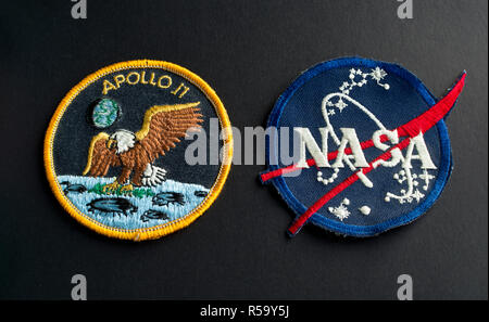 Apollo 11 mission patch and NASA badge. - Stock Image