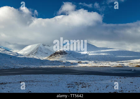 Rannoch Moor in Scotland in winter with snow covered mountains - Stock Image
