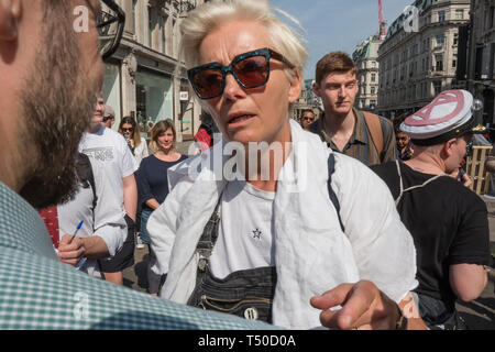 London, UK. 19th April 2019. Dame Emma Thompson arrives to speak at Extinction Rebellion's Sea of Protest in Oxford Circus around large pink yacht, names after the Honduran environmental activist Berta Cáceres, assassinated in 2016. She came as a part of the activities to show 'Love For The Earth' on the 5th day of the occupation, but which were interrupted by police shortly after she spoke. Credit: Peter Marshall/Alamy Live News - Stock Image