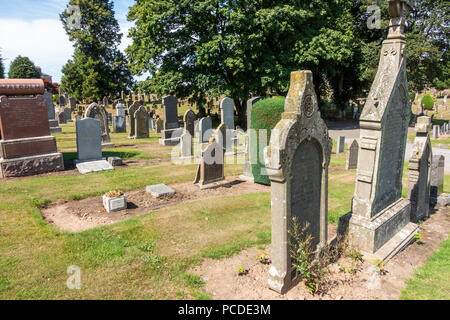 Graves in the cemetery at Kirriemuir in Scotland. A place to go an remember loved ones. - Stock Image