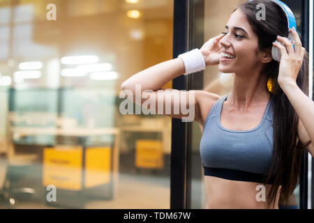 Picture of young attractive happy fitness woman outdoor - Stock Image
