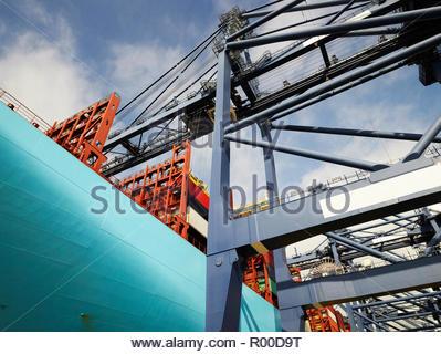 Crane and cargo ship at Port of Felixstowe, England - Stock Image