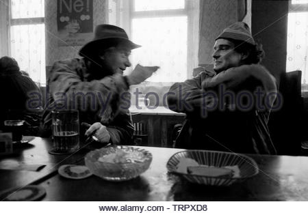 Czechoslovakia, Prague,1989 during the Velvet Revolution, the fall of communism in Eastern Europe. Tractor plant workers having just finished their night shift enjoy beer and bread for breakfast in a nearby bar. COPYRIGHT PHOTOGRAPH BY BRIAN HARRIS  © 07808-579804 - Stock Image