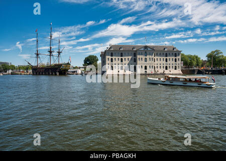 Dutch Shipping Museum in Amsterdam with sloops - Stock Image