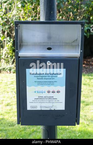 Safe community needle disposal box in a Helsinki park. - Stock Image