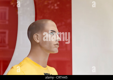 Portrait of a male dummy in window display. - Stock Image