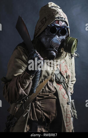Studio shot of a nuclear post apocalypse survivor in tatters. - Stock Image