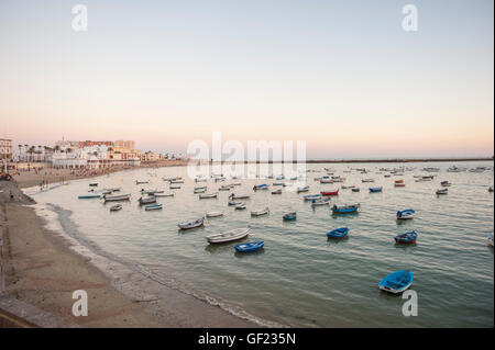 View of La Caleta beach, at sunset.    La Caleta is a small beach located at the tip of the historic quarter of - Stock Image