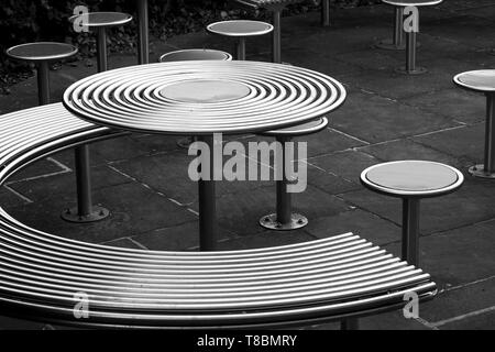 Polished stainless steel outdoor furniture - Stock Image
